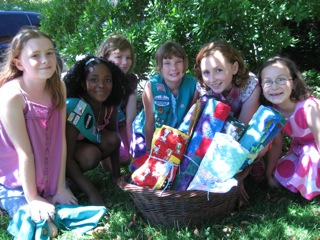 Girl Scouts deliver quilts to donate.
