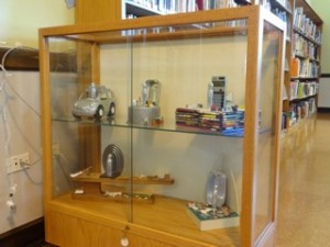 Display case at Dole Library with art work by Elaine Luther, copyright 2011, 2013