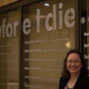 Elaine Luther with Before I Die Wall at SEA Conference 2015, photo by Deb Garman