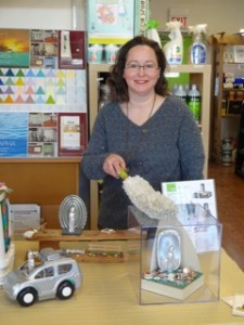Elaine Luther Dusting Art at Green Home Experts