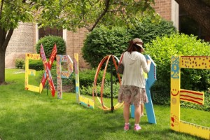 Library patrons paint letters at Forest Park Library - Elaine Luther, art installation