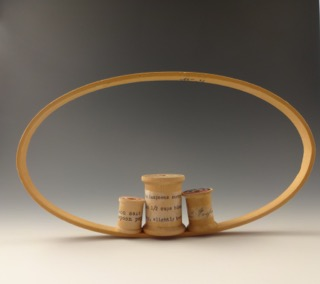 """Oval with Three Spools"""