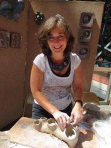 Artist Gina Lee Robbins demonstrates sculpting.