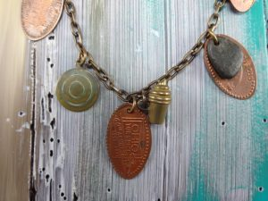 """Oh, the Places You'll Go"" Necklace by Elaine Luther, copyright Elaine Luther 2016.  Detail showing Ohio Turnpike souvenir penny."