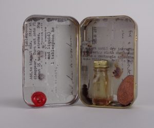 Assemblage Perfume Bottle Tin, by Elaine Luther.