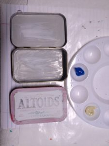 Painting mint tins, photo by Elaine Luther