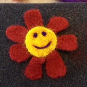 Student work, Felted Flower with Smiley Face!