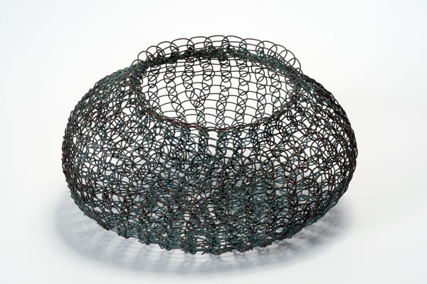 Ruth Asawa, Basket, 1948-1949, woven copper wire, 4.5 x 7.5 x 7.75 inches. Black Mountain College Collection, Museum purchase with funds provided by 2010 Collectors' Circle with additional funds provided by Frances Myers, 2011.01.02.58. Asheville Art Museum.