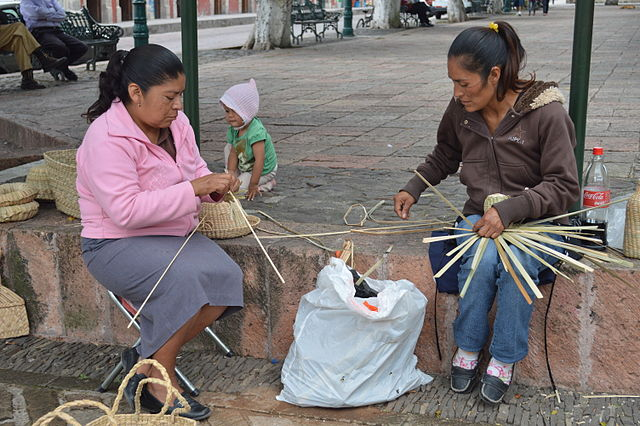 Two women Weaving Baskets in Cuitzeo, Michoacán, Mexico, 2013.