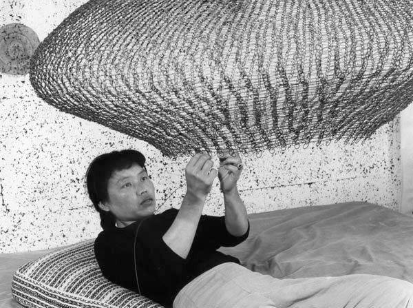 Ruth Asawa at work, 1957. Photograph by Imogen Cunningham.