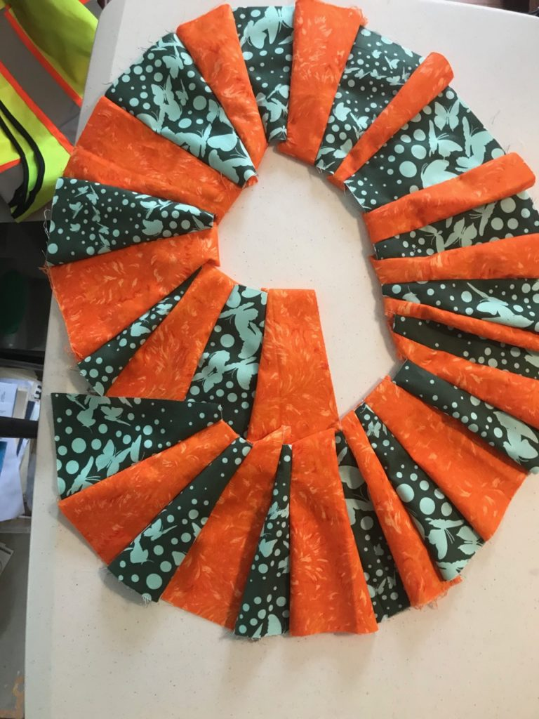 Teal and Orange Improv Quilting Experiment by Elaine Luther