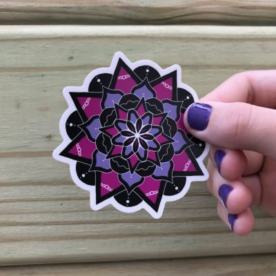 Mandala Sticker by Maria Romero Luther; mandala in magenta, purple and black and white.