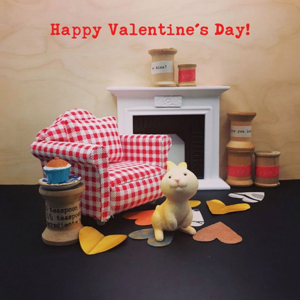 Happy Valentine's Day! photo with miniature furniture, fireplace, bunny, hearts and spools. Photo Copyright Elaine Luther 2021.