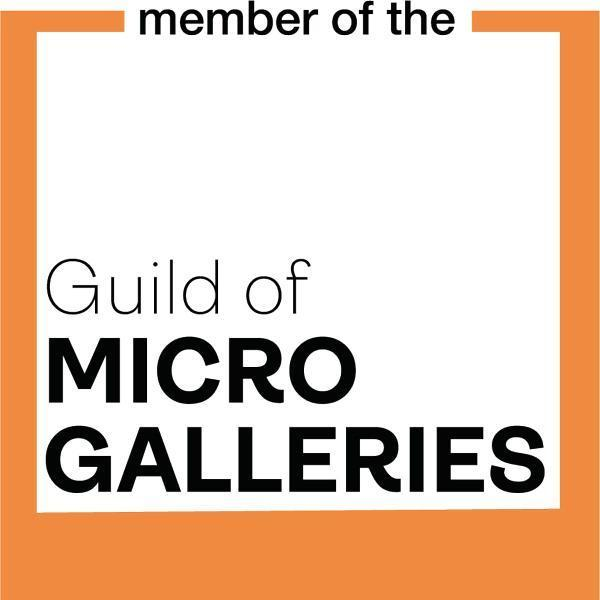 An orange frame has black text that says: Member of the Guild of Micro Galleries