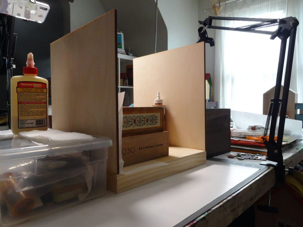 Building a Miniature Gallery; supporting the side walls as the glue dries.