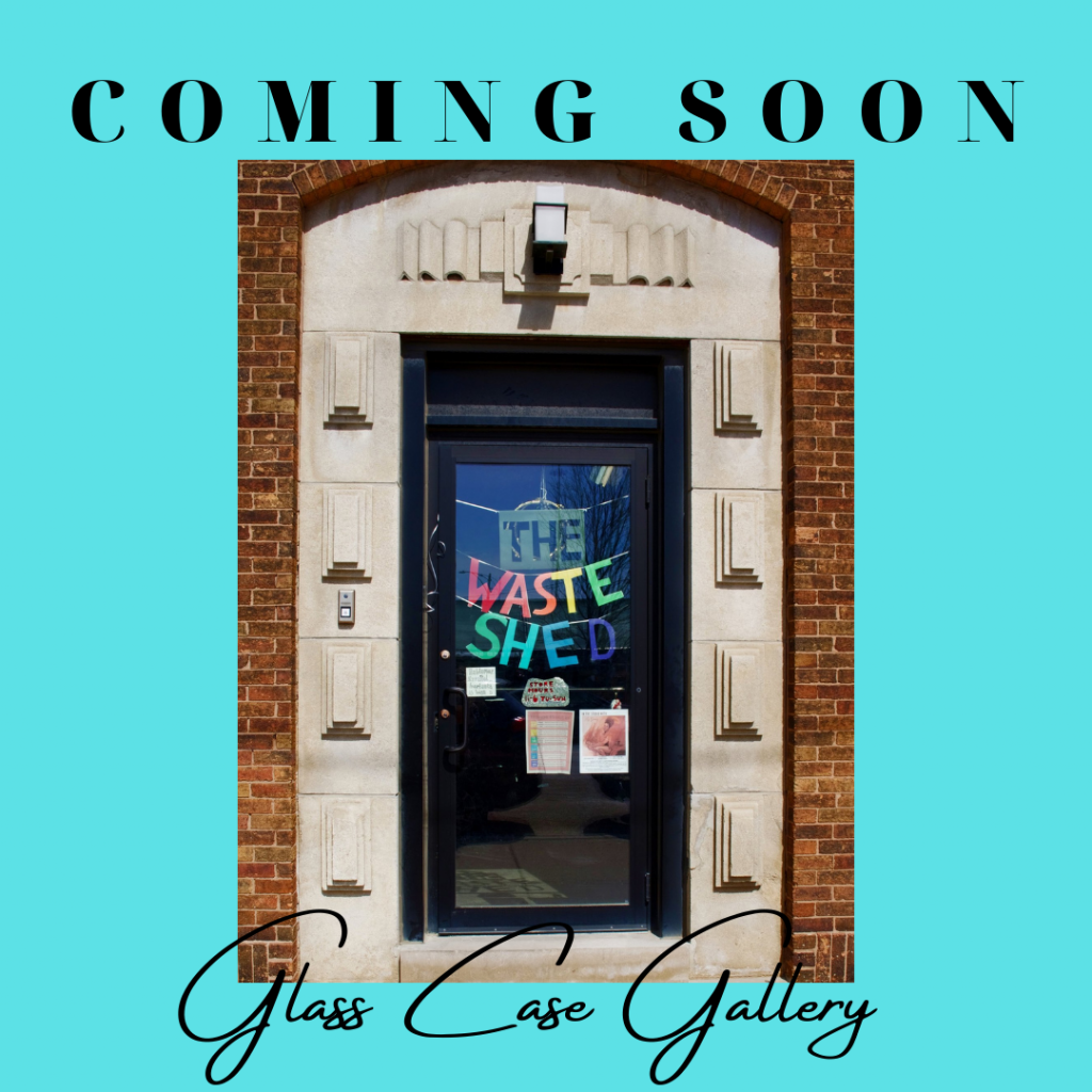 """An image graphic says """"Coming Soon: Glass Case Gallery,"""" and has a photo of the doorway of The Waste Shed. The background of the graphic is light blue."""
